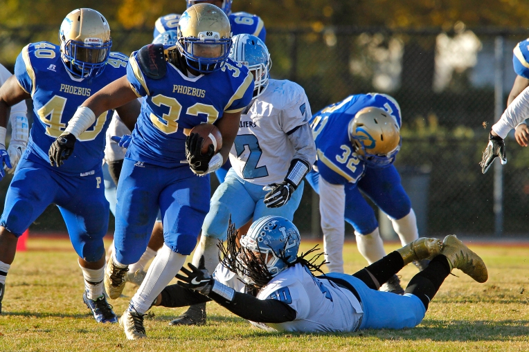Phoebus' Daniel Wright avoids the tackle of Lakeland's Erick Grant during Saturday's Group 3A state quarterfinal game at Darling Stadium November 26, 2016.