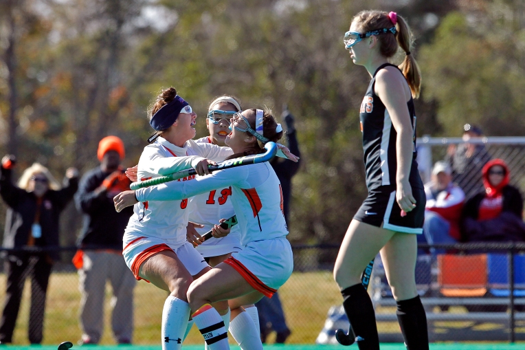 Tabb's Sarah Mueller, left, celebrates scoring a goal with Alex Morales, center, and Miya Denison, right, during Saturday's Group 3A state championship game against James Monroe at the USA National Field Hockey Training Center in Virginia Beach November 12, 2016.