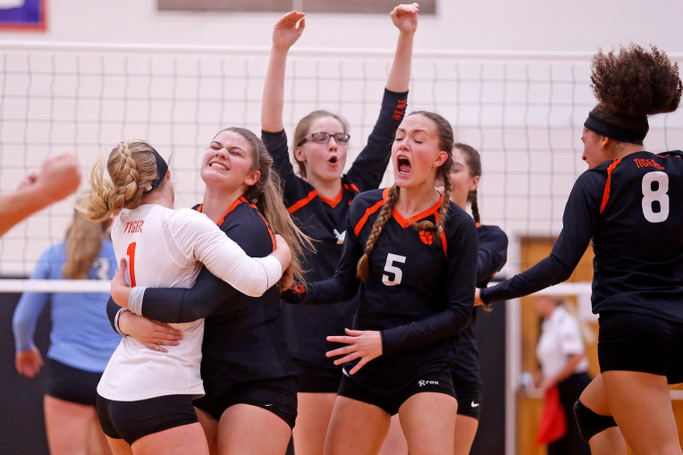 Tabb players celebrate after defeating Warhill during Thursday's 3A East Region volleyball championship November 10, 2016.