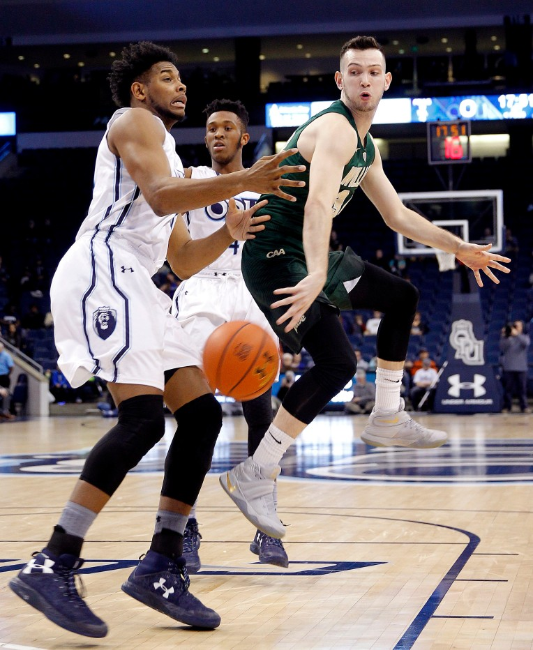 William & Mary's David Cohn passes the ball around Old Dominion's Brandon Stith during the first half of their game Thursday December 29, 2016 in Norfolk.
