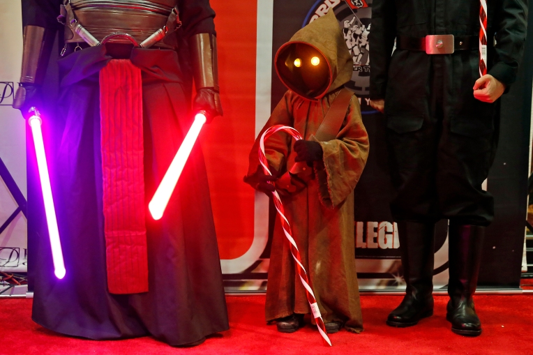 Fans dressed in costumes stand in the lobby of Paragon Theater before the premiere of Rouge One: A Star Wars Story Thursday evening December 15, 2016.