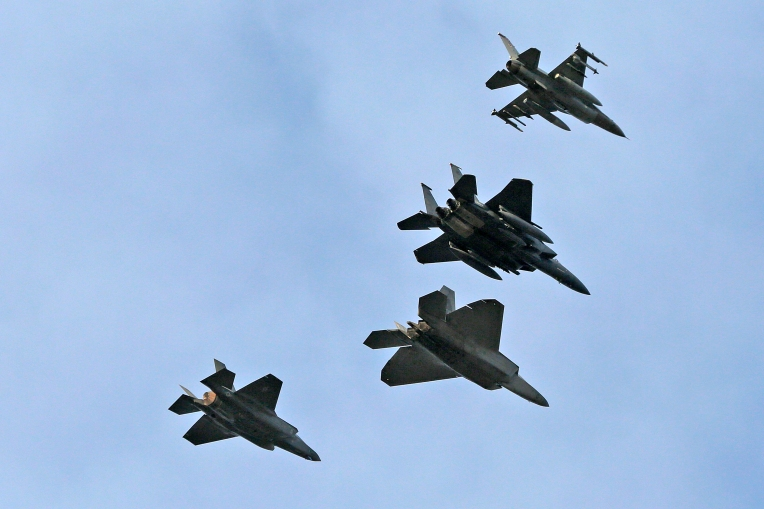 A four-aircraft military flyover rehearses Thursday afternoon January 19, 2017 at Langley Air Force Base. The flyover will be part of Friday's inauguration and will include a F-16, top, F-15, F-22 and a F-35, bottom.