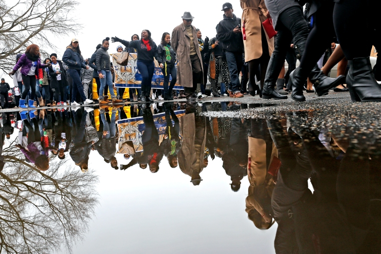 Hundreds of Hampton University students and community members march along Emancipation Drive Monday morning during the annual Martin Luther King, Jr. march and program January 16, 2017.