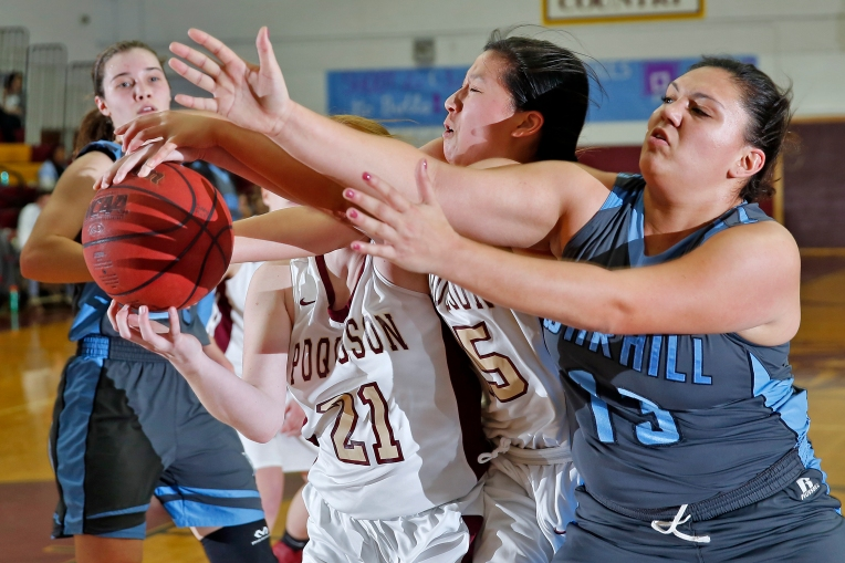 Warhill's Keelx Rochard, right, chases after a loose ball with Poquoson's Ashland Forrest, left, and Sondra Fan, center, during Friday's game January 27, 2017.