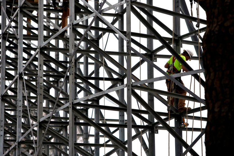 Construction crews work on the new wooden roller coaster, InvadR, at Busch Gardens Wednesday afternoon February 22, 2017.