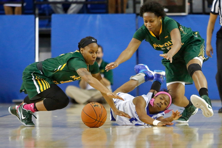 Hampton University's K'lynn Willis, center, chases after a loose ball with Norfolk State's Dominique Harper, left, and Alexys Long during Monday evening's game at the Convocation Center February 27, 2017.