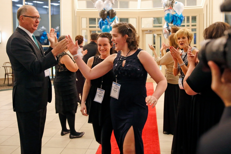 Ryanne Tyler walks the red carpet with her buddy Savannah Phillips, left, during A Night to Shine at Northside Christian Church Friday February 10, 2017. A Night to Shine allows community members with special needs to enjoy a night out similar to a prom and is sponsored by the Tim Tebow Foundation.