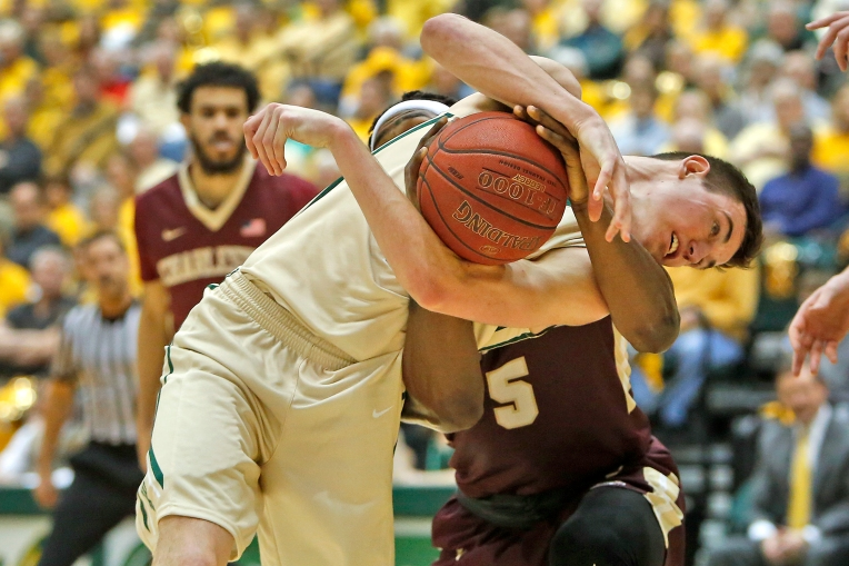 William and Mary's Omar Prewitt fights for control of the ball with Charleston's Jarrell Brantley during Saturday's game at Kaplan Arena February 11, 2017.